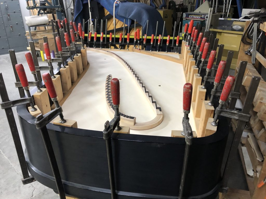 Soundboard Glued and Drying with clamps in place in a Concert Grand.
